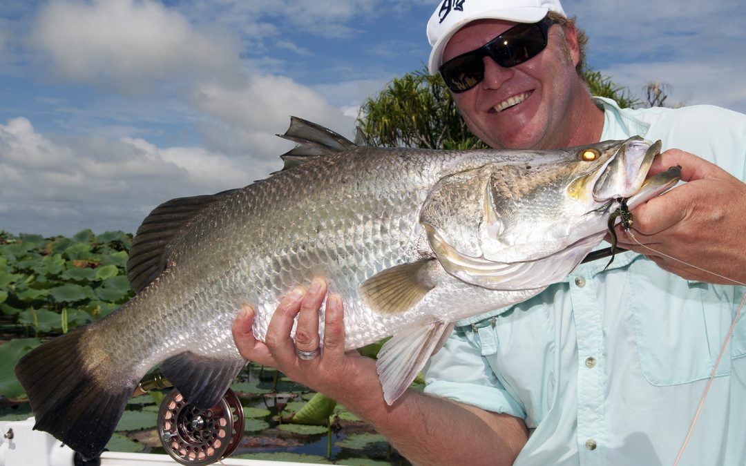 Bretto Wilson shows off his 78cm fly caught barra from Corroboree Billabong in the Northern Territory ©Fishotopia 2018