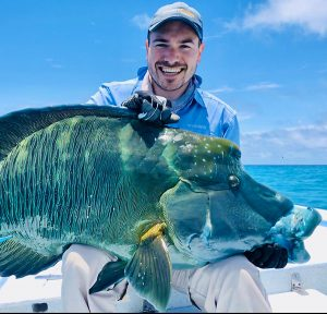 Inner Circle member Ryan Keith with a large blue wrasse he caught