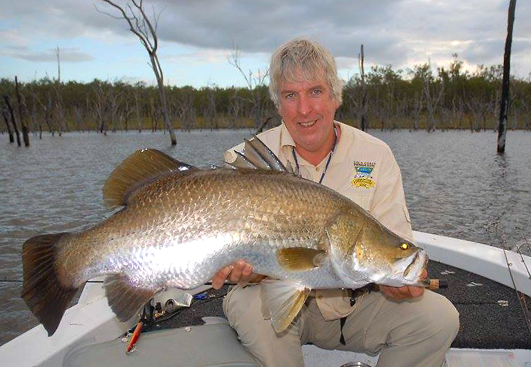 Dr David Green holds his 101cm barra from Monduran