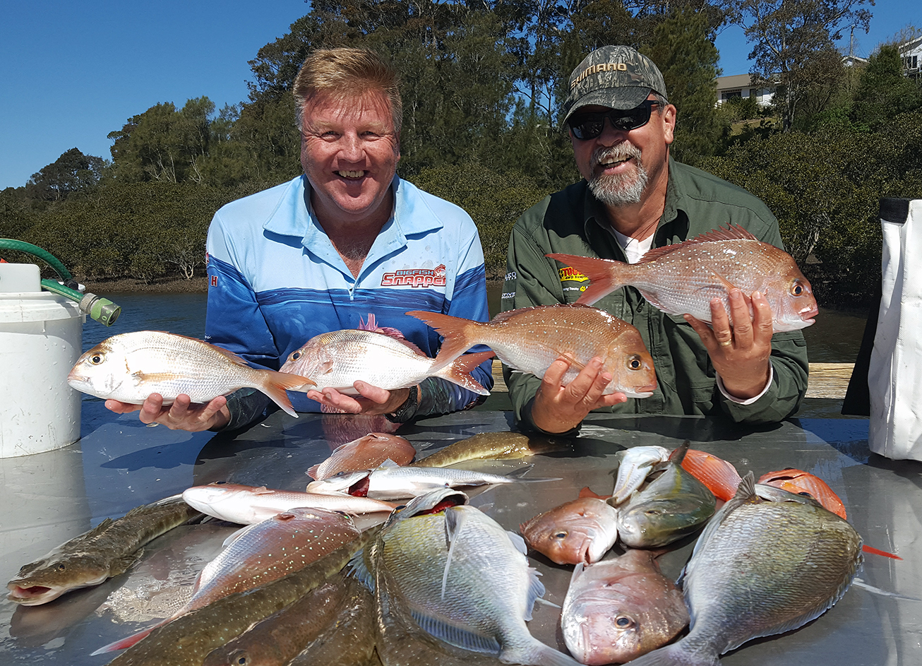 A typical offshore catch being cleaned beside the boat ramp at Moruya, NSW.