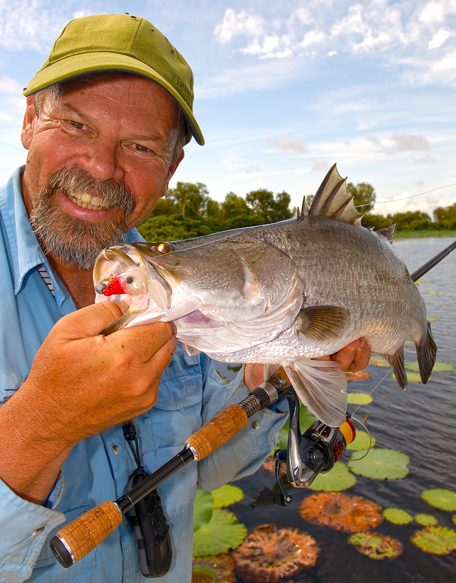 Starlo with a nice barramundi, pulled from amongst the lilies at Corroboree Billabong.