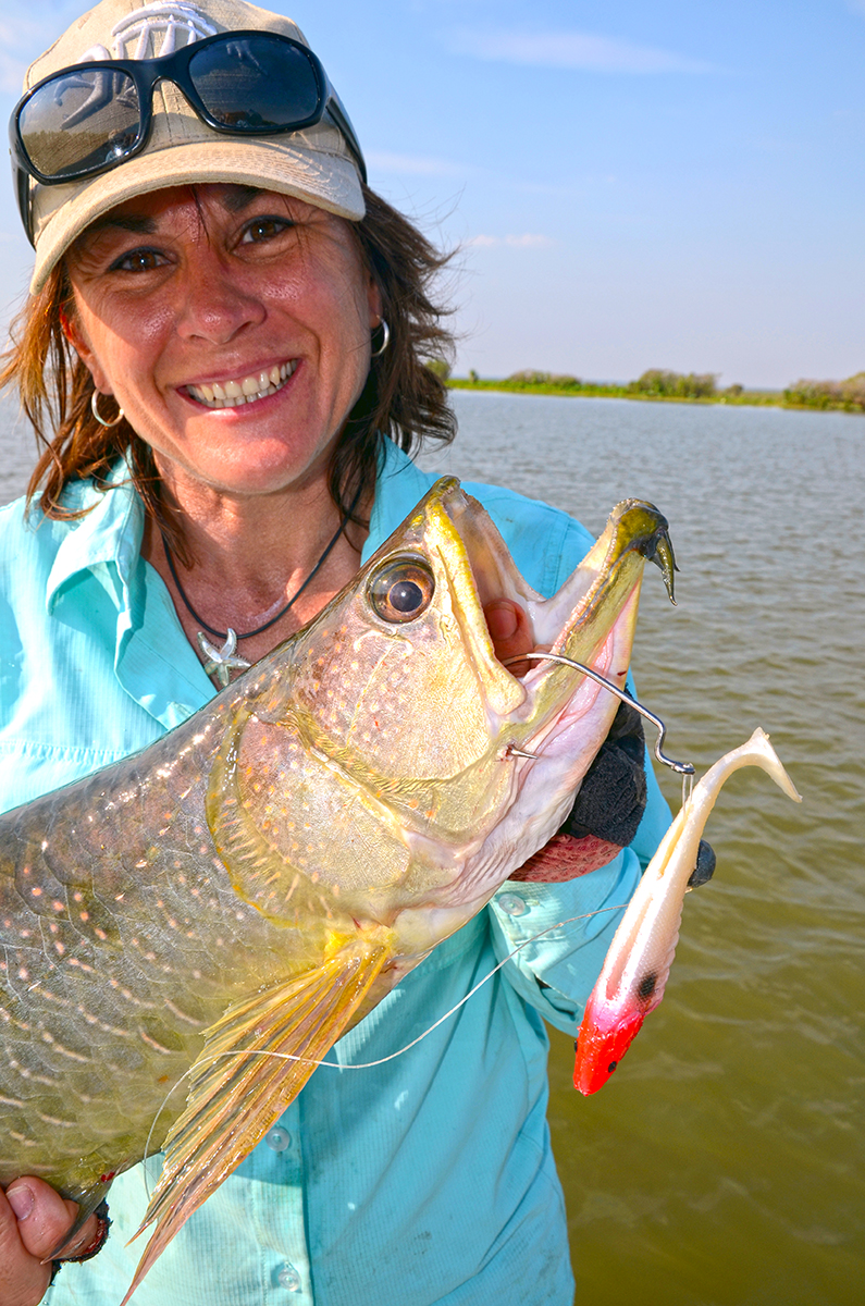 Jo with a saratoga caught on a soft plastic lure in Corroboree Billabong, NT.